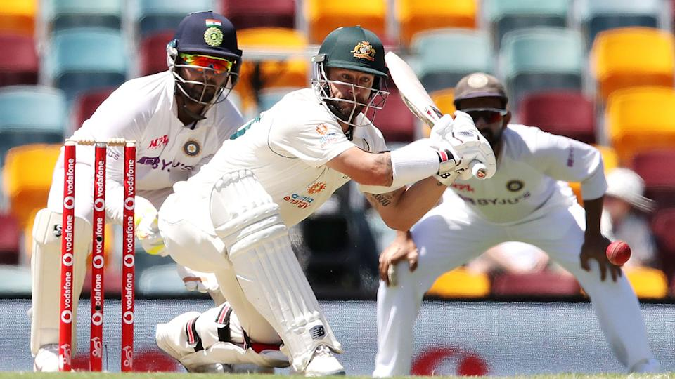 Seen here, Matthew Wade shapes up to play a sweep shot against India.