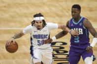 Orlando Magic guard Cole Anthony (50) brings the ball up next to Charlotte Hornets guard Terry Rozier (3) during the second half of an NBA basketball game in Charlotte, N.C., Friday, May 7, 2021. (AP Photo/Nell Redmond)