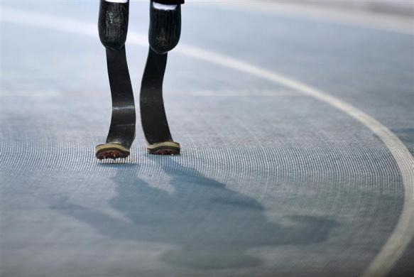 Oscar Pistorius of South Africa walks before the men's 400 meters semi-final at the IAAF World Championships in Daegu August 29, 2011.