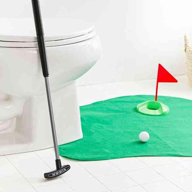 "<p><strong>Urban Outfitters</strong></p><p>urbanoutfitters.com</p><p><strong>$16.00</strong></p><p><a href=""https://www.urbanoutfitters.com/shop/toilet-golf-game2"" rel=""nofollow noopener"" target=""_blank"" data-ylk=""slk:Shop Now"" class=""link rapid-noclick-resp"">Shop Now</a></p><p>This might make him take longer in the bathroom, but he'd probably much rather practice his putting instead of reading magazines while ... doing other things. </p>"
