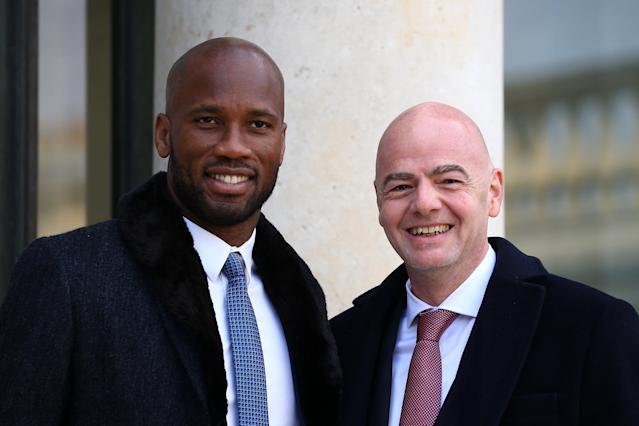FIFA President Gianni Infantino and former soccer player Didier Drogba pose as they arrive for a lunch with French President Emmanuel Macron and Liberian President George Weah at the Elysee Palace in Paris, France, February 21, 2018. REUTERS/Stephane Mahe