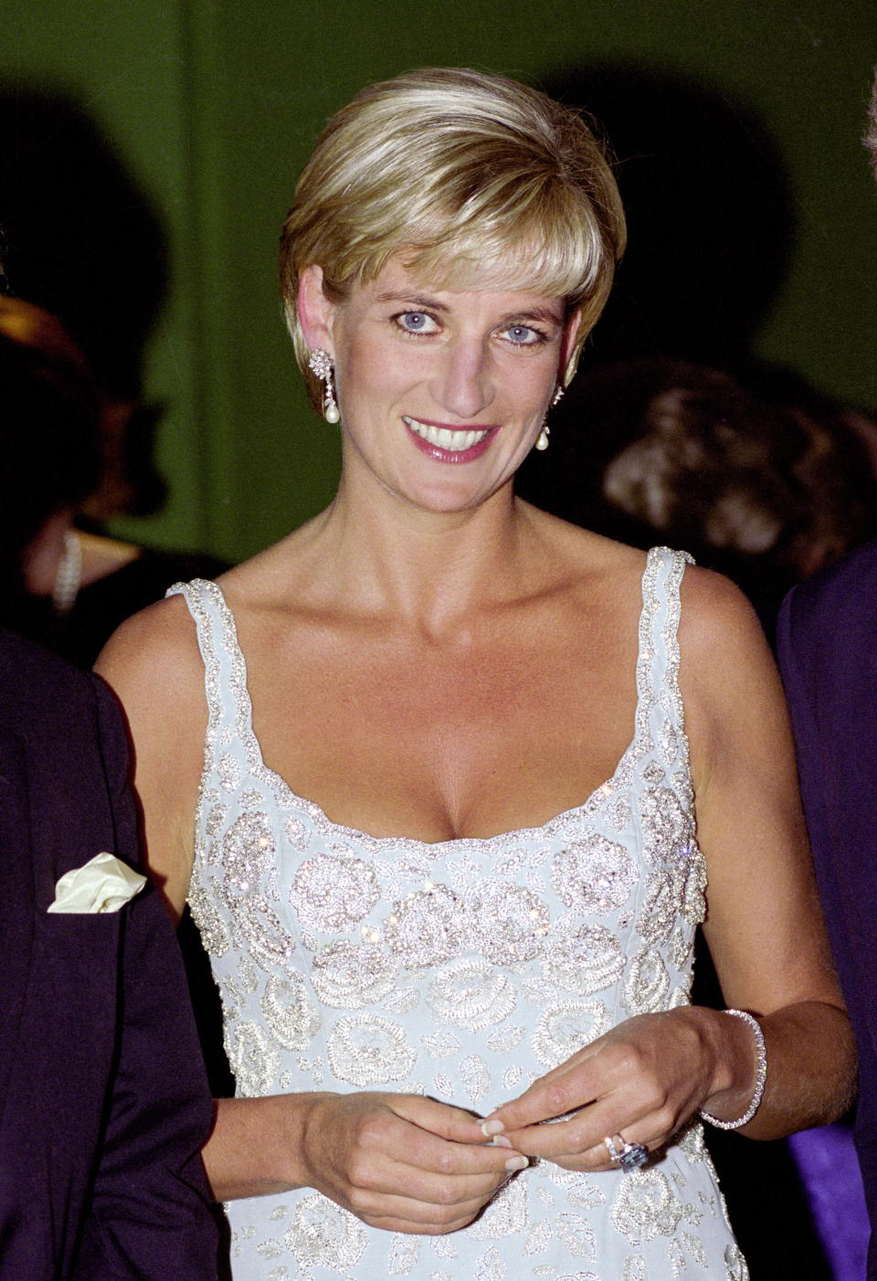 LONDON, UNITED KINGDOM - JUNE 02:  Diana, Princess Of Wales Wearing An Embroidered Cocktail Dress Designed By Fashion Designer Catherine Walker At The Private Viewing And Reception At Christies To Raise Funds For The Aids Crisis Trust And The Royal Marsden Hospital Cancer Fund.  (Photo by Tim Graham Photo Library via Getty Images)