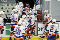 New York Islanders leave the ice after they were defeated in the overtime period of an NHL hockey game against the Boston Bruins, Monday, May 10, 2021, in Boston. The Bruins won 3-2 in overtime on a goal by Bruins left wing Taylor Hall. (AP Photo/Elise Amendola)