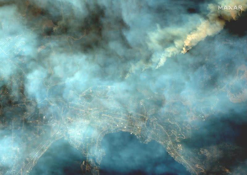 Maxar satellite image shows smoke from the East Troublesome wildfires at Grand Lake in Colorado