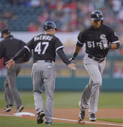 Chicago White Sox's Alex Rios (51) is greeted by third base coach Joe McEwing after hitting a solo home run against the Los Angeles Angels in the first inning of a baseball game, Friday, May 17, 2013 in Anaheim, Calif. (AP Photo/Mark J. Terrill)