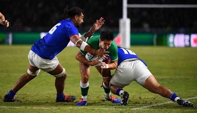 Ireland's fly-half Joey Carbery is tackled by Samoa's flanker Chris Vui. (Credit: Getty Images)