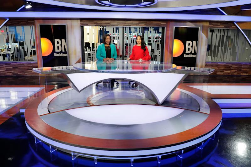 Black News Channel morning co-anchors Lauren McCoy, left and Rarione Maniece sit on set Tuesday, Jan. 7, 2020.