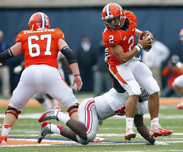 Illinois quarterback Nathan Scheelhaase (2) avoids the sack by Ohio State defensive lineman Noah Spence (8) during the first half of an NCAA college football game on Saturday, Nov. 16, 2013, in Champaign, Ill. (AP Photo/Jeff Haynes)