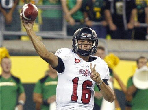 Arkansas State quarterback Ryan Aplin throws during the first half of their NCAA college football game against Oregon in Eugene, Ore., Saturday, Sept. 1, 2012. (AP Photo/Don Ryan)