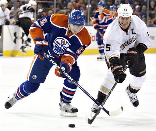 Anaheim Ducks' Ryan Getzlaf (15) battles with Edmonton Oilers' Ladislav Smid during the first period of their NHL hockey game in Edmonton, Alberta, Sunday, April 21, 2013. (AP Photo/The Canadian Press, Jason Franson)