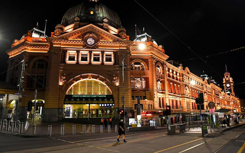 People cross a street in Melbourne's central business district as five million residents in Australia's second biggest city emerged from an almost two-month overnight curfew - AFP