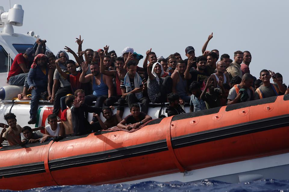 Migrants on an Italian Coast Guard vessel react after being rescued during a joint rescue operation with the German NGO migrant rescue ship Sea-Watch 3 around 63 nautical miles south-west of the Italian island of Lampedusa, in the western Mediterranean Sea, August 2, 2021.  REUTERS/Darrin Zammit Lupi