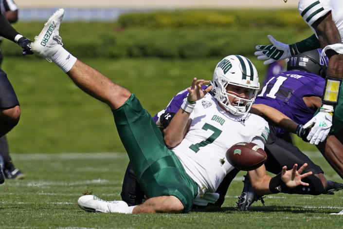 Ohio quarterback Kurtis Rourke fumbles the ball during the first half of an NCAA college football game against Northwestern in Evanston, Ill., Saturday, Sept. 25, 2021. (AP Photo/Nam Y. Huh)