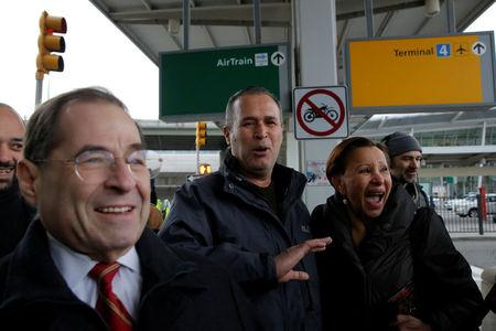 Iraqi immigrant Hameed Darwish (C) walks out of Terminal 4 with Congressman Jerrold Nadler (L) and Congresswoman Nydia Velazquez (R) after being released at John F. Kennedy International Airport in Queens, New York, U.S.
