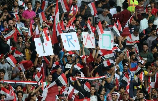 Iraq football fans cheer for the national side during a recent friendly football match against Qatar