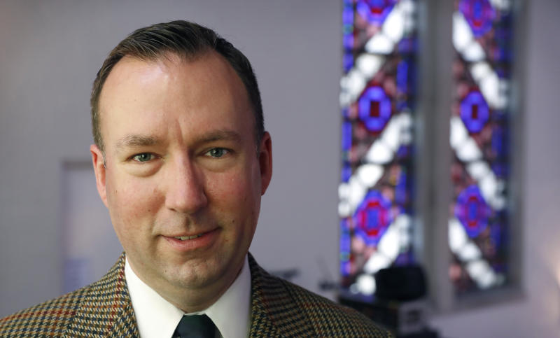 """Central Presbyterian Church Pastor Wallace Bubar stands for a photo in his church in Des Moines, Iowa, on Friday, May 5, 2017. Bubar described President Donald Trump's Thursday, May 4, 2017 executive order as """"pandering to the religious right."""" He does not foresee any effect on his church or any other. """"For whatever reason, the religious right evangelicals have developed a persecution complex here in the last few years, and I think this is intended to address that,"""" Bubar said. (AP Photo/Charlie Neibergall)"""