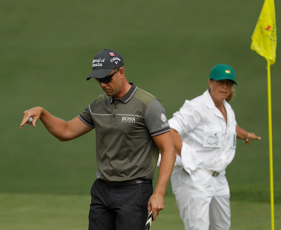 Henrik Stenson, of Sweden, reacts to his putt on the second hole during the first round for the Masters golf tournament Thursday, April 11, 2019, in Augusta, Ga. (AP Photo/Chris Carlson)