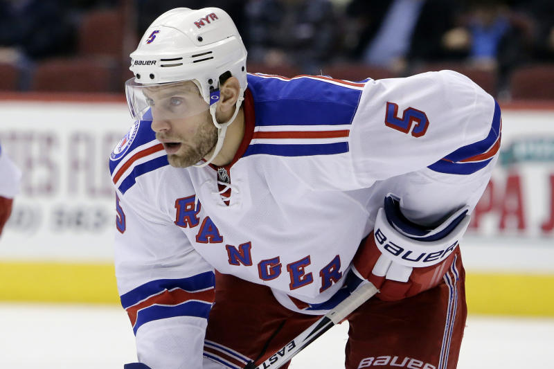 FILE - In this Dec. 29, 2016, file photo, New York Rangers defenseman Dan Girardi (5) gets set for a faceoff during the first period during an NHL hockey game against the Arizona Coyotes in Glendale, Ariz. The former New York Rangers and Tampa Bay Lightning defenseman has announced his retirement from the NHL after 13 seasons on Friday, Sept. 20, 2019. (AP Photo/Rick Scuteri, File)