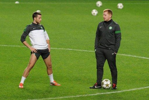 Celtic FC's defender Adam Matthews (L) and coach Neil Lennon take part in a training session at Luz Stadium in Lisbon, on the eve of their UEFA Champions League group G football match against SL Benfica