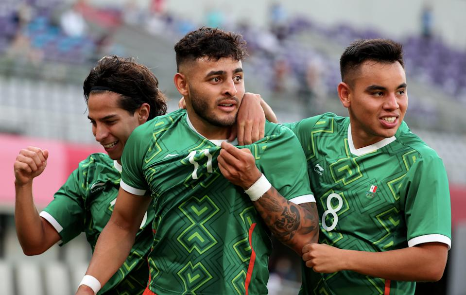 CHOFU, JAPAN - JULY 22: Diego Lainez of Team Mexico (L) celebrate his goal with teammates Alexis Vega #11 and Carlos Rodriguez #8 in the Men's First Round Group A match during the Tokyo 2020 Olympic Games at Tokyo Stadium on July 22, 2021 in Chofu, Tokyo, Japan. (Photo by Xavier Laine/Getty Images)