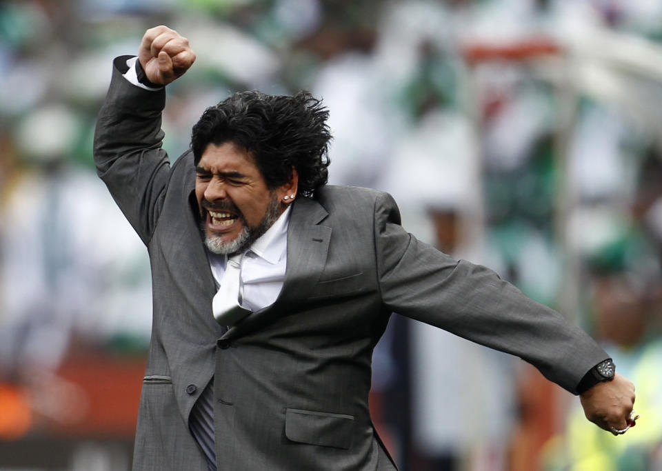 Argentina's coach Diego Maradona celebrates his team's goal against Nigeria during the 2010 World Cup Group B soccer match at Ellis Park stadium in Johannesburg June 12, 2010.   REUTERS/Eddie Keogh (SOUTH AFRICA  - Tags: SPORT SOCCER WORLD CUP IMAGE OF THE DAY TOP PICTURE)   FOR BEST QUALITY AVAILABLE: ALSO SEE GM1E73T01CG01