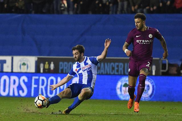 Wigan 1 Manchester City 0: Will Grigg's on fire as Pep Guardiola fumes in FA Cup shock after Fabian Delph red card