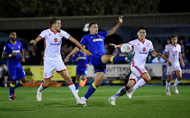 "Soccer Football - League One - AFC Wimbledon vs Milton Keynes Dons - Kingsmeadow, London, Britain - September 22, 2017 AFC Wimbledon's Cody Mcdonald in action with MK Dons' Scott Wootton Action Images/Tony O'Brien EDITORIAL USE ONLY. No use with unauthorized audio, video, data, fixture lists, club/league logos or ""live"" services. Online in-match use limited to 75 images, no video emulation. No use in betting, games or single club/league/player publications. Please contact your account representative for further details."
