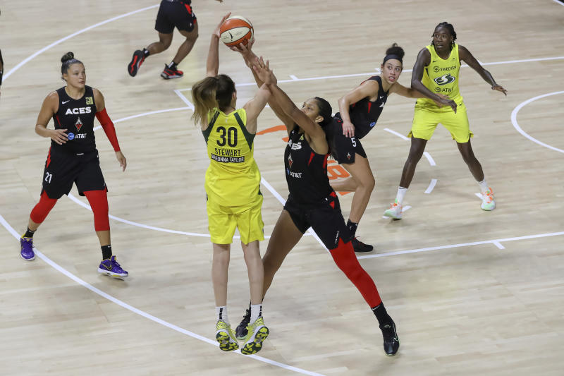 Seattle Storm's Breanna Stewart is blocked by A'ja Wilson near the 3-point line.