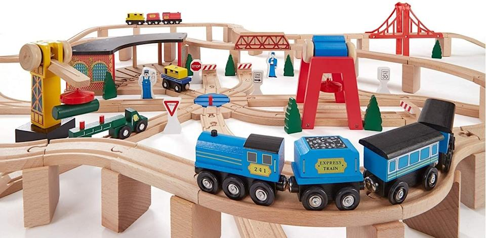 """The set includes 100 track sections, a freight train, a passenger train and a flatbed truck, so kids have plenty of options to choo-choo-choose from without ever getting bored.<br /><br /><strong>Promising review:</strong>""""This is literally everything you could ever ask for from Melissa & Doug. Everything is well made, not a single piece with a blemish. Strong sturdy box with a handle on it to help with carrying it around. (It's heavy considering that it's for children. Adult recommended for moving the whole thing)<strong>Possibilities are endless with track set up. My son plays for hours on end and there is no end to his enjoyment when he opens up the box and starts to set up</strong>. Great toys don't have to have batteries and this one proves it."""" —<a href=""""https://amzn.to/3vftRaz"""" target=""""_blank"""" rel=""""noopener noreferrer"""">Jeremy W.</a><br /><strong><br />Get it from Amazon for<a href=""""https://amzn.to/3sJtiUO"""" target=""""_blank"""" rel=""""noopener noreferrer"""">$97.99</a>.</strong>"""