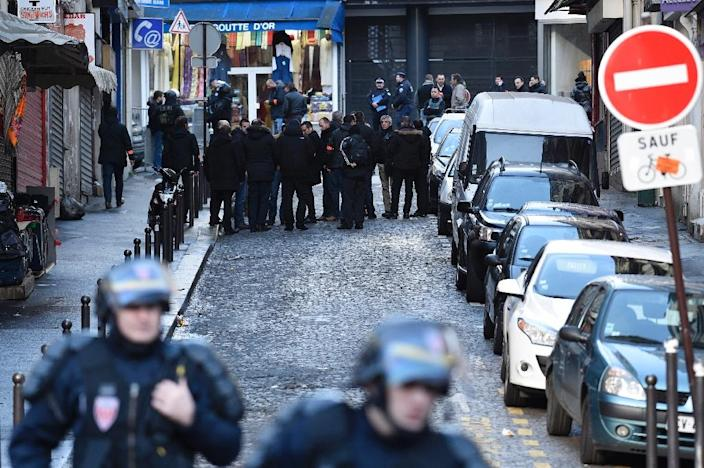 French police near the Rue de la Goutte d'Or in the north of Paris on January 7, 2016, after police shot a man dead as he was trying to enter a police station (AFP Photo/Lionel Bonaventure)