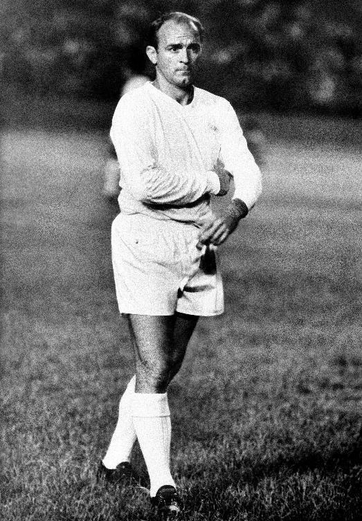 FILE - In this Aug. 25, 1963 file photo, Alfredo Di Stefano walks on the pitch at the end of the Little World Cup Series first soccer match, in which Real Madrid defeated Oporto 2 -1, Caracas, Venezuela. Di Stefano, whose goals placed him alongside the all-time great players and propelled Real Madrid to five straight European Champions Cups, has died on Monday, July 7, 2014. He was 88. (AP Photo, File)