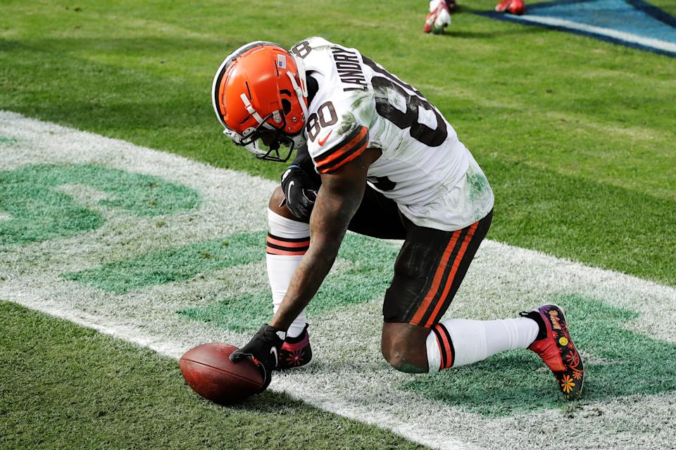 Browns wide receiver Jarvis Landry lays the ball down after catching a touchdown pass against the Titans in the first half Sunday, Dec. 6, 2020, in Nashville, Tenn. (AP Photo/Ben Margot)