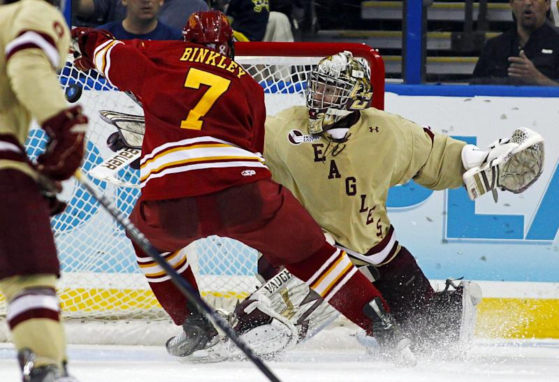Boston College goalie Parker Milner makes a save on Ferris State's Jason Binkley during the second period of the NCAA Frozen Four college hockey tournament final, Saturday, April 7, 2012, in Tampa, Fla. (AP Photo/Mike Carlson)