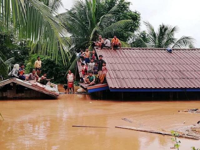 <p>Villagers evacuate after the Xepian-Xe Nam Noy hydropower dam collapsed in Attapeu province, Laos, July 24, 2018. (Photo: ABC Laos News/Handout via Reuters) </p>