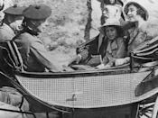 <p>King George V, the Duke and Duchess of York, and Princess Elizabeth take a trip in the Royal carriage.</p>