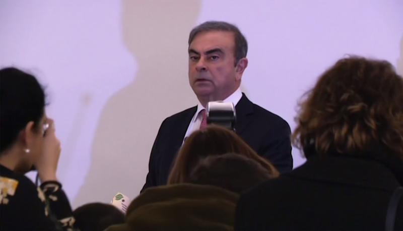 An image grab taken from an AFP video shows former Nissan chief Carlos Ghosn arriving to hold a press conference in Beirut on January 8, 2020, the first by the fugitive car magnate since his escape from trial in Japan. (Photo by - / AFP) (Photo by -/AFP via Getty Images)