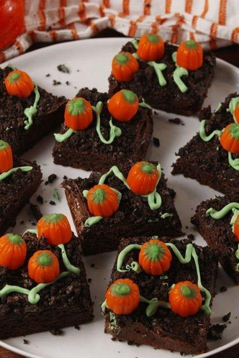 """<p>Pumpkin patch brownies turn a regular boxed brownie into the cutest <a href=""""https://www.delish.com/uk/food-news/a29395786/aldi-liqueurs/"""" rel=""""nofollow noopener"""" target=""""_blank"""" data-ylk=""""slk:Autumn dessert"""" class=""""link rapid-noclick-resp"""">Autumn dessert</a>. Top with crushed Oreos for dirt and nestle royal icing pumpkins to look like they are growing from the ground! So simple yet so sweet!</p><p>Get the <a href=""""https://www.delish.com/uk/cooking/recipes/a33979227/pumpkin-patch-brownies-recipe/"""" rel=""""nofollow noopener"""" target=""""_blank"""" data-ylk=""""slk:Pumpkin Patch Brownies"""" class=""""link rapid-noclick-resp"""">Pumpkin Patch Brownies</a> recipe.</p>"""