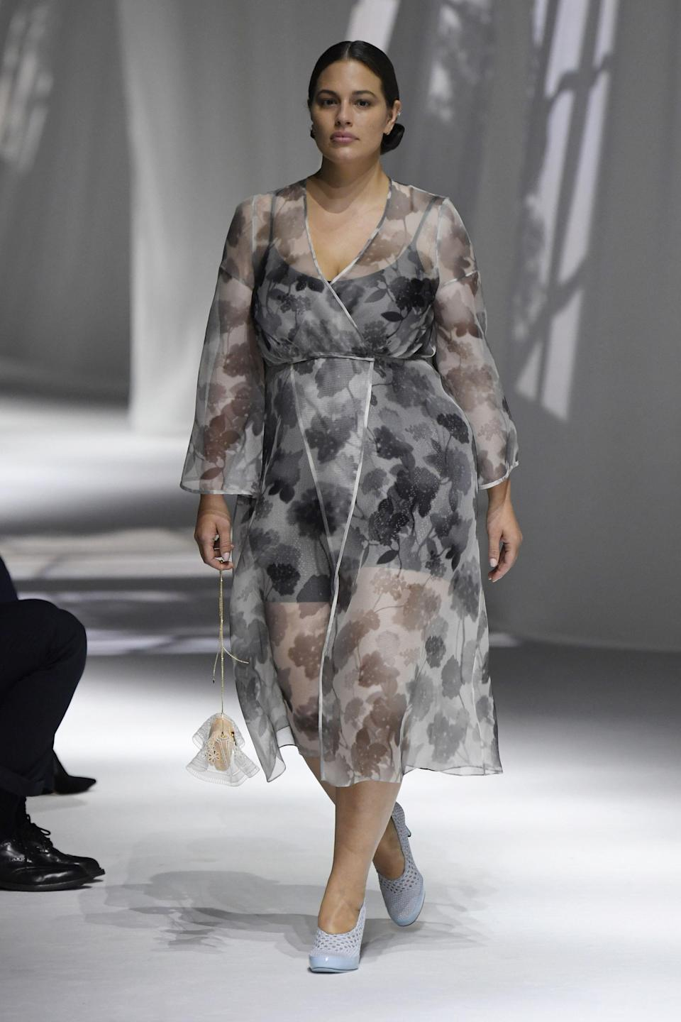 """<p>""""Acknowledging the gravity of a moment, clothes tell stories of the rigour of Italian craft and the emotion of our universal experience,"""" stated Fendi's press release following their runway show. As a fashion house with a storied history that spans generations, the meaning of family is reimagined in their spring-summer collection. The brand honed in on its heritage and craftsmanship, something they spent ample time contemplating during COVID-19. </p><p>This reflection took direct interpretation in the form of a clean color palette, flaxen linen, and crisp white cotton nightgowns, contrasted by playful notes of vibrant cerulean and fuchsia. Stay-at-home orders made its most obvious appearance in the form of comforter duvets reworked as vests or jackets and dragged across the floor by model Paloma Elsesser. Speaking of models, Fendi cast actual families, featuring mothers, fathers, sisters and sons. Even the accessories were a nod to time in quarantine. Socks are worn with slippers like a paternal figure would, the plastic market bag is reinterpreted in laser-cut PVC, and a miniature baguette is covered in grandma's doily. </p><p>Fendi's runway show was the first in-person presentation during MFW, and speaks volumes to what Italy and the industry has endured. A quiet family home is a welcome respite. </p><p><em>Click through to see every look from Fendi's spring-summer 2021 runway show. </em><br></p>"""