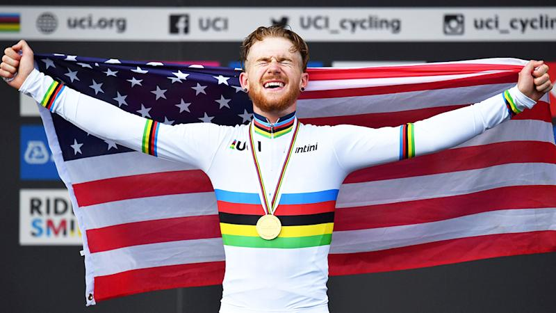 Quinn Simmons celebrates with the American flag after winning the Men Junior Road Race at the 2019 UCI Road World Championships. (Getty Images)