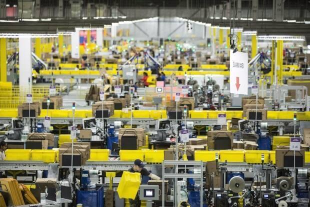 Employees work at the Amazon fulfilment centre in Brampton, Ont. in November.