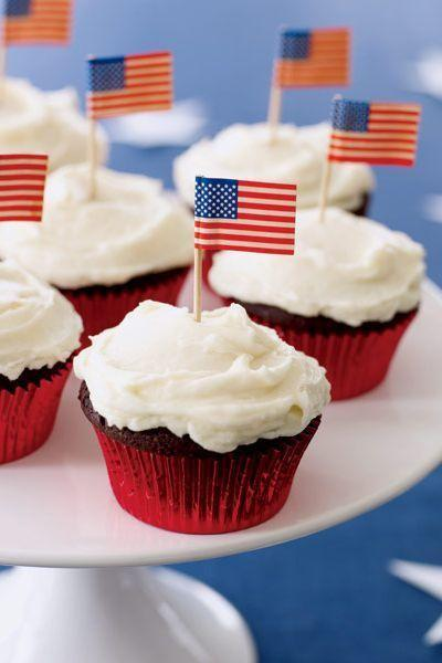"""<p>Not only do these cupcakes have an ultra-gooey peanut butter filling, they're also topped with mini American flags for the ultimate festive touch.</p><p><em><a href=""""https://www.goodhousekeeping.com/food-recipes/a4346/chocolate-peanut-butter-cupcakes/"""" rel=""""nofollow noopener"""" target=""""_blank"""" data-ylk=""""slk:Get the recipe for Chocolate-Peanut Butter Cupcakes »"""" class=""""link rapid-noclick-resp"""">Get the recipe for Chocolate-Peanut Butter Cupcakes »</a></em></p><p><strong>RELATED: </strong><a href=""""https://www.goodhousekeeping.com/holidays/g2069/4th-of-july-recipes/"""" rel=""""nofollow noopener"""" target=""""_blank"""" data-ylk=""""slk:59 Easy 4th of July Recipes Your Family Will Devour"""" class=""""link rapid-noclick-resp"""">59 Easy 4th of July Recipes Your Family Will Devour</a> </p>"""