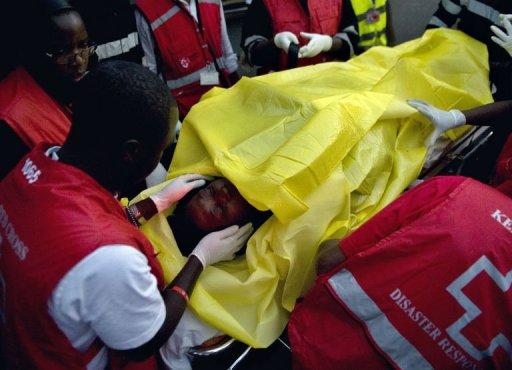 A victim of one of the attacks is wheeled by paramedics to a waiting ambulance