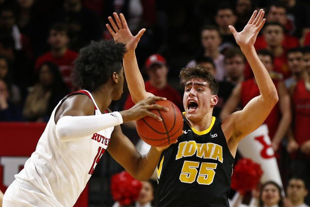 Iowa forward Luka Garza (55) shouts at Rutgers center Myles Johnson (15) during the first half of an NCAA college basketball game Saturday, Feb. 16, 2019, in Piscataway, N.J. (AP Photo/Adam Hunger)