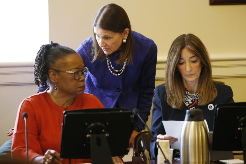 Virginia State Sen. Mamie Locke, D-Hampton, left, confers with House speaker, Eileen Filler-Corn, right, along with House clerk, Suzette Denslow, center, during a joint session of the House and Senate Rules Committees at the Virginia State Capitol in Richmond, Va., Friday, Jan. 10, 2020. The committee passed rules restricting gun access to the State buildings. (AP Photo/Steve Helber)