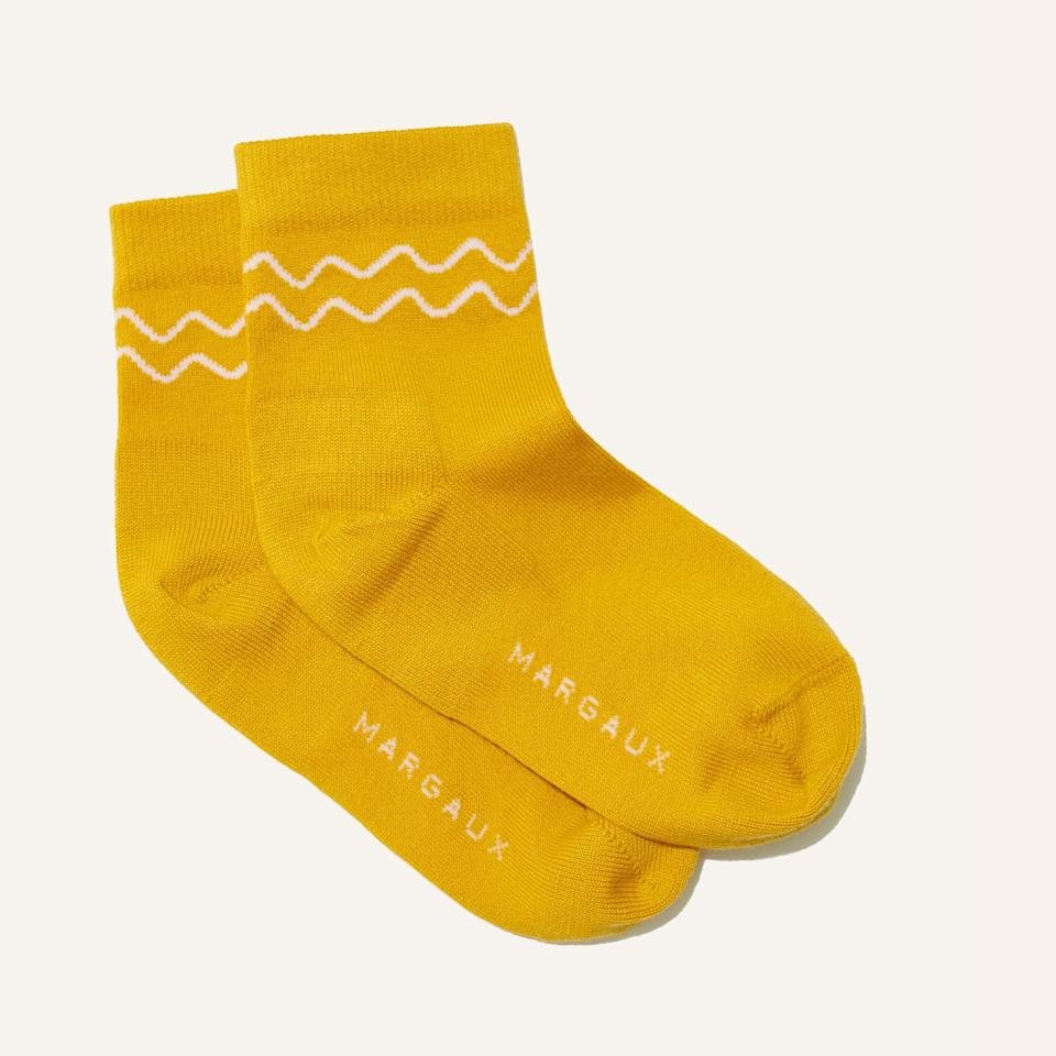 """<h2>Margaux Cotton-Cashmere Sock<br></h2><br>The gift of foot coverings need not be a snooze-fest — especially when the sock in question is rendered in a luxe, super-soft fabric blend and a cheerful mustard hue.<br><br><em>Shop <strong><a href=""""https://margauxny.com/"""" rel=""""nofollow noopener"""" target=""""_blank"""" data-ylk=""""slk:Margaux"""" class=""""link rapid-noclick-resp"""">Margaux</a></strong></em><br><br><strong>Margaux</strong> The Sock, $, available at <a href=""""https://go.skimresources.com/?id=30283X879131&url=https%3A%2F%2Fmargauxny.com%2Fcollections%2Fthe-sock%3Fcolor%3DOchre"""" rel=""""nofollow noopener"""" target=""""_blank"""" data-ylk=""""slk:Margaux"""" class=""""link rapid-noclick-resp"""">Margaux</a>"""