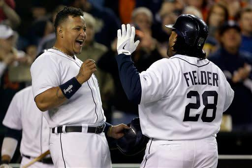 Detroit Tigers' Prince Fielder (28) is met at the dugout by Miguel Cabrera after hitting a three-run home run off Minnesota Twins starting pitcher Mike Pelfrey during the sixth inning of a baseball game in Detroit, Monday, April 29, 2013. (AP Photo/Carlos Osorio)