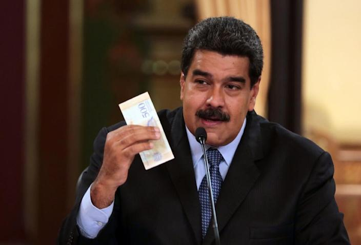 Handout picture released by the Venezuelan Presidency showing President Nicolas Maduro. Friday, Maduro said he would not miss a chance to meet with US President Donald Trump (AFP Photo/HO)