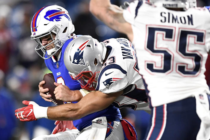 Buffalo Bills quarterback Derek Anderson takes a hit from New England Patriots linebacker Kyle Van Noy during the second half of an NFL football game, Monday, Oct. 29, 2018, in Orchard Park, N.Y. Anderson left the game with an injury after the play. The Patriots won 25-6. (AP Photo/Adrian Kraus)