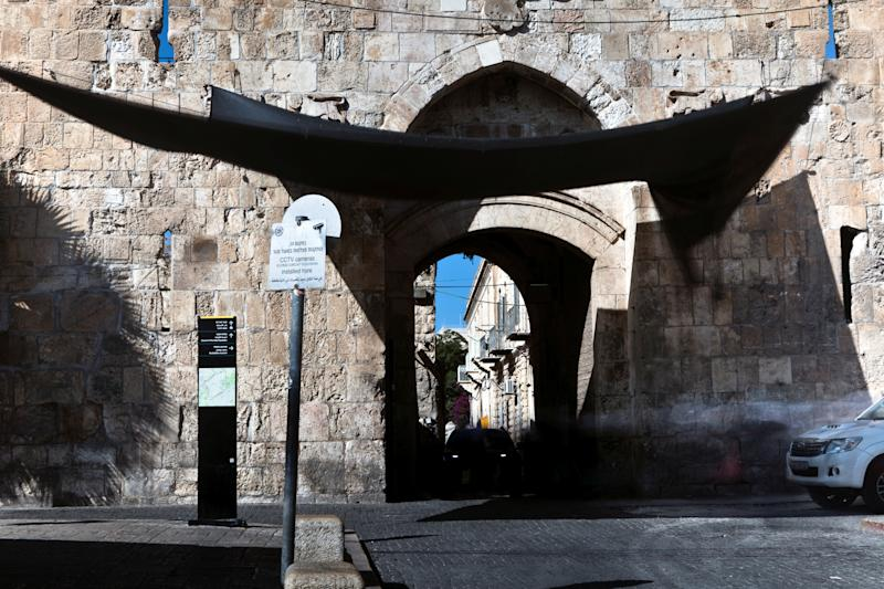 A car enters through Lions' Gate in Jerusalem's Old City. (Photo: Nir Elias/Reuters)