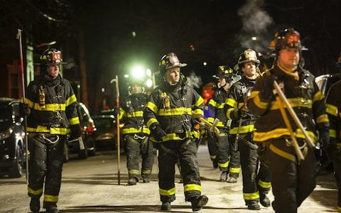 Firefighters leave after putting out the major fire - Credit:  Amir Levy/ Getty